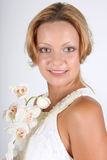 Portrait of woman with white orchid Royalty Free Stock Images