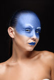 Portrait of a woman who is covered with blue paint Royalty Free Stock Photo