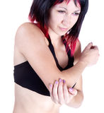 Portrait of woman who has  elbow pain Royalty Free Stock Images