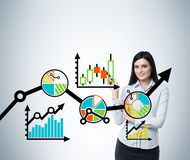 Portrait of woman who points out the business optimisation scheme. Colourful scheme of the business process on the glass s Stock Images