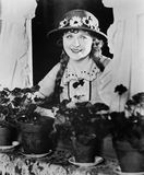 Portrait of woman in window with flower pots Royalty Free Stock Photos