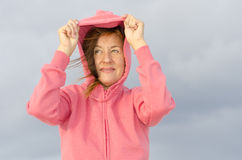 Portrait of woman in windy autumn weather Royalty Free Stock Image