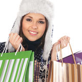 Portrait of a woman in a winter hat holding bags Royalty Free Stock Photography