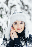 Portrait of a woman in a winter hat on a snow background Royalty Free Stock Photos