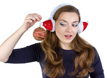 Portrait of woman in winter headphones with ball Royalty Free Stock Image