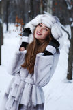 Portrait of woman in winter landscape Stock Images