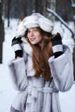 Portrait of woman in winter landscape Royalty Free Stock Image