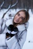 Portrait of woman in winter landscape Stock Photo