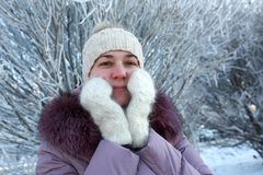 Woman in winter park. Portrait of a woman in winter park Stock Photography