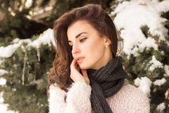 Young woman in winter park. Portrait of woman in winter park near the winter tree Royalty Free Stock Image