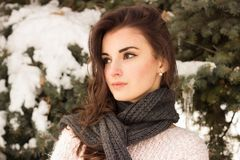 Young woman in winter park. Portrait of woman in winter park near the winter tree Royalty Free Stock Images