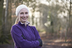 Portrait Of Woman On Winter Run Through Woodland Royalty Free Stock Images