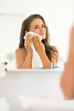 Portrait of woman wiping with towel in bathroom Royalty Free Stock Photography