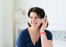 Portrait of woman with wireless headphones Royalty Free Stock Photo