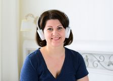 Portrait of woman with wireless headphones Royalty Free Stock Photography