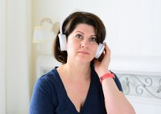 Portrait of woman with wireless headphones Royalty Free Stock Photos