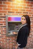 Portrait of a woman withdrawing cash Stock Photography