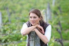 Portrait of woman worker standing in vineyards Stock Images