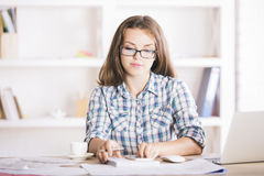 Portrait of woman working on project Royalty Free Stock Photo