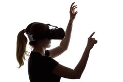 Portrait of a woman working in three-dimensional space in virtua. Silhouette portrait of a young woman working in three-dimensional space in virtual reality Stock Images