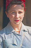 Portrait of woman in World War 2 period. Portrait of woman with red head square, red lipstick and 1940's hair style taking part in Historic Scotland's Royalty Free Stock Images