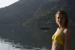 Portrait Of Woman In Yellow Bikini Against Lake Royalty Free Stock Photos