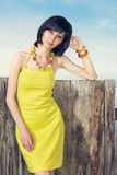 Portrait of woman in yellow dress Royalty Free Stock Photos