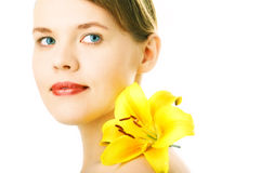 Portrait woman with yellow lily royalty free stock photo