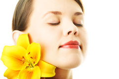 Portrait woman with yellow lily Royalty Free Stock Image