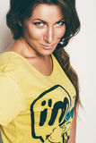 Portrait of woman in yellow top. In studio Royalty Free Stock Photo