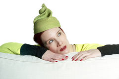 Portrait of woman with yellow vintage hat. Portrait of red-haired woman with yellow hat stock photo