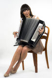 Portrait of woman. Young Woman with acordeon on white background Royalty Free Stock Photo