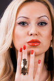 Portrait of a woman. Portrait of a young woman with gold ring over royalty free stock image