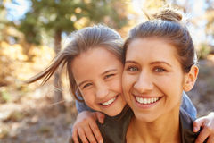 Portrait Of Woman With Younger Sister In Autumn Woodland Stock Photos