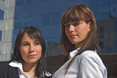 Portrait of women. A portrait of two girls one beside the other downtown Royalty Free Stock Photo