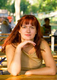 Portrait of the women. With red hair sitting on a summer verandah in cafe Stock Images