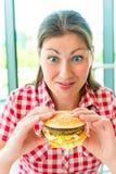 Portrait of  women and appetizing hamburger Stock Photos