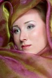 Portrait of a  women covered in violet fabrics Stock Photo