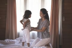 Portrait woman and daughter prepared clothes royalty free stock photos
