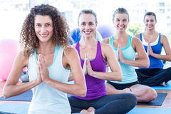 Portrait of women doing easy pose with hands joined Royalty Free Stock Photo