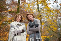 Portrait of Women Friends in Autumn. Portrait of two European women smiling in autumn Stock Photography