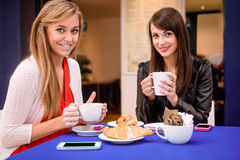 Portrait of women having coffee and snacks at a coffee shop Stock Photography