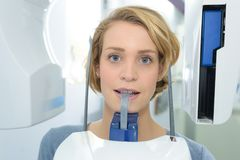 Portrait woman having dental xray Stock Photos