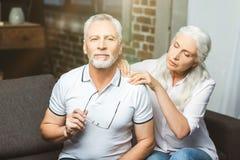 Woman making shoulder massage for man stock photo