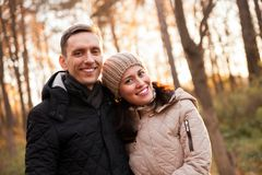 Couple on walk in autumn park. royalty free stock photography
