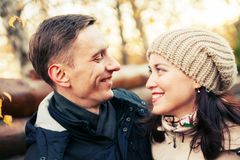 Couple on walk in autumn park. Portrait of women and men on walk in autumn forest stock photo