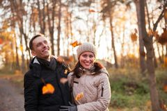 Young girl with guy in autumn park. Portrait of women and men on walk in autumn forest stock photography
