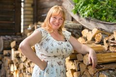 Portrait of a women near woodpile Royalty Free Stock Images