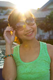 Portrait women with sunglass in flare Stock Photo