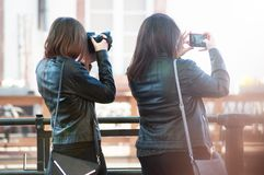 Portrait of women taking a picture in the street of Strasbourg on back view royalty free stock photo